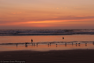 Sunset and waders at Pismo Beach California