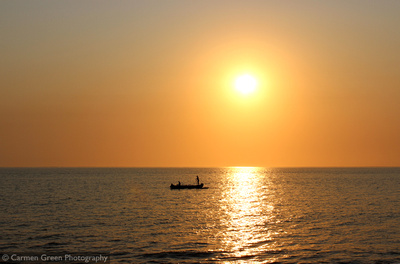 Malagasy sunset with local fishermen